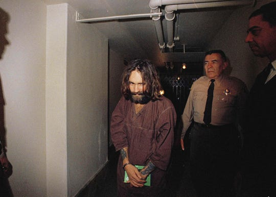 In this 1969 file photo, Charles Manson is escorted to court in Los Angeles.
