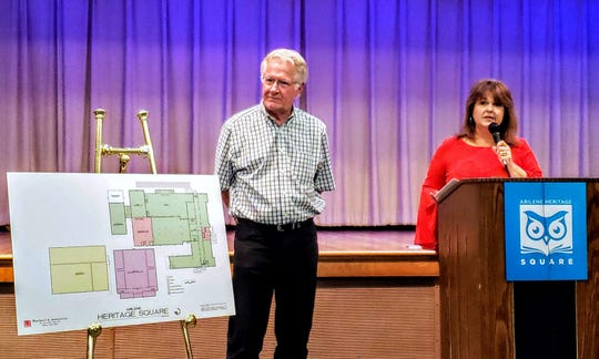 Architect Rick Weatherl and Grace Museum Executive Director Laura Moore show off plans for a portion of the Abilene Heritage Square Friday. The announcement for the future of the former Lincoln Middle School was made at the Main Branch of the Abilene Public Library.