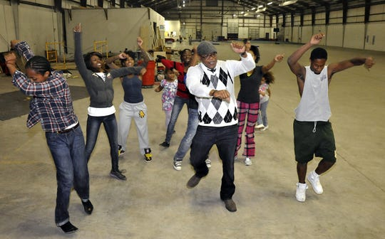 Michael Hayes leads students in a break dance class at the W.N.C. Urban Arts Institute, an after-school that involves kids in dance and performance activities.