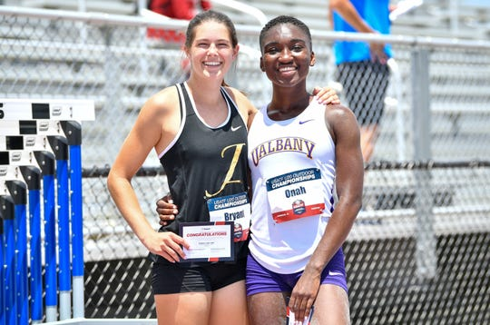 Claire Bryant and Ijeyikowoicho Onah pose after competing in the Women's Long Jump final during the USA Track & Field U20 Outdoor Championships at Ansin Sports Complex on June 23, 2019 in Miramar, Florida.