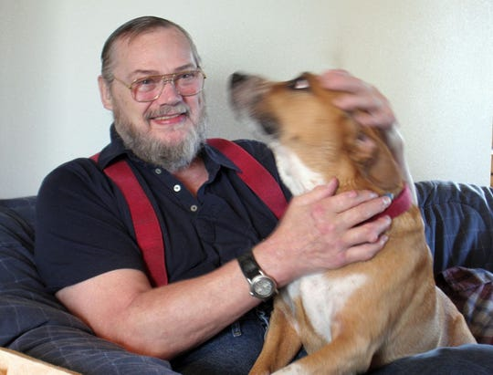 Wayne Foster, with his dog Tyson, in 2006. Foster was one of the best athletes to come out of Kitsap County, playing college football at WSU and in the Canadian Football League. He died July 13 from complications of kidney disease.