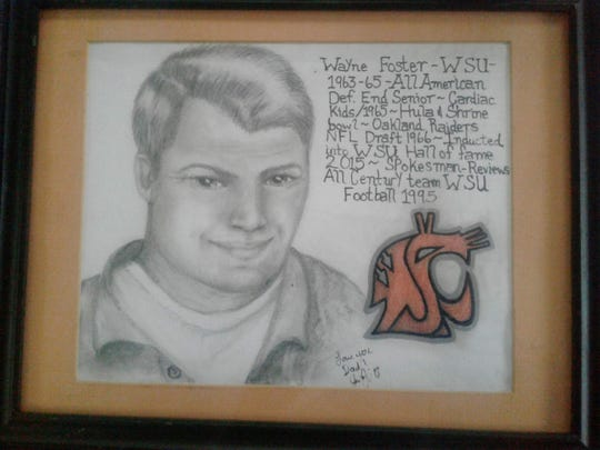 A drawing of Wayne Foster by his daughter, Jessie, memorializes some of the South Kitsap native's football accomplishments.