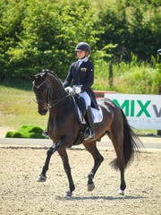 Holy Trinity graduate Micah Deligdish competes in dressage with Destiny, hoping to qualify for the 2020 Olympic Games.