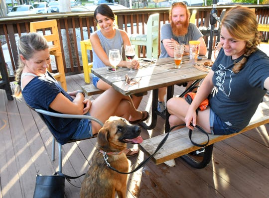 The outdoor deck is dog friendly, and Jack was the center of attention, and he knew it. Crafty Crane Bar is located at 2101 Henley Court in downtown Melbourne is a craft beer and gourmet wine bar that also provides artisanal cheese and charcuterie boards.