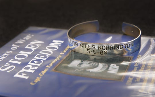 A POW bracelet bears the name of Capt. Giles Norrington, who was a prisoner in Vietnam from 1968 until 1973. Norrington, now a Titusville resident, is featured in the pictured DVD.
