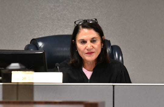 At a guardian hearing in Judge Lisa Davidson's courtroom at the Moore Justice Center in Viera, guardian Manda Wright replaced Rebecca Fierle for two Brevard residents as their guardian. Judge Lisa Davidson at the hearing.