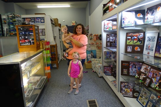 Angela Lewis stands with two of her children, Garrusin Lewis, 1, and  Tali Lewis, 4, at Hidden Treasures in Galion.