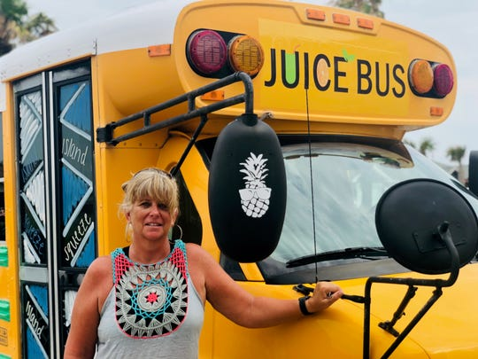 Jorgi Kurtz, of North Padre Island, bought a school bus and transformed it into a mobile juice bar — Island Squeeze.