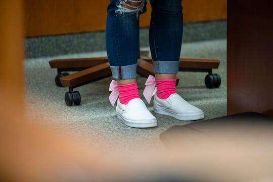 Keirstyn Myers, 22, wears pink socks with bows in honor of 3-year-old Charlette Dawkins at Friday's sentencing of Travis Graham.