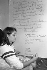 Caryl  Wolford, a member of the Junior Fair Board, adds her name to a sign in the junior fair building to welcome fairgoers in 1969.