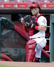 Cincinnati Reds catcher Tucker Barnhart (16) waits to take the field before the first inning of an MLB baseball game against the Colorado Rockies, Friday, July 26, 2019, at Great American Ball Park in Cincinnati.