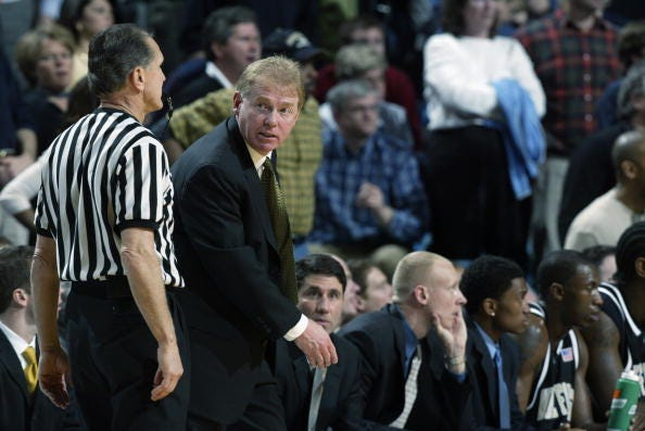 Head coach Skip Prosser of Wake Forest talks to a referee during the game against the University of North Carolina at Chapel Hill Tar Heels at the Dean E. Smith Center on February 2, 2003 in Chapel Hill, North Carolina.