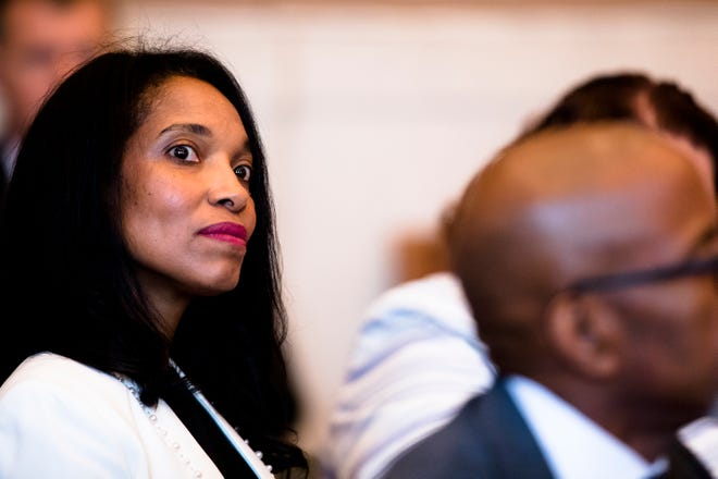 Former judge Tracie Hunter sits in the courtroom of Hamilton County Common Pleas Judge Patrick Dinkelacker on Monday, July 22, 2019. Hunter was ordered to serve a six-month jail sentence that was imposed more than four years ago.