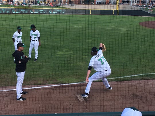 Dayton Dragons pitcher Nick Lodolo (23) throws a warm-up pitch at Fifth Third Field on July 25, 2019, in Dayton. Lodolo was the Cincinnati Reds' 1st-round pick in the 2019 MLB Draft.