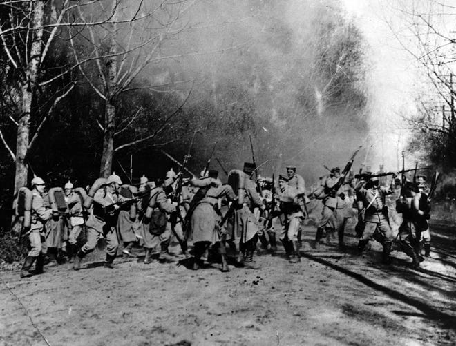 One a day in mid-September, 1914, near Berry-au-bae, in France, a German scouting party stumbled on a French outpost in a clearing near the Argonne forest. The resulting scene produced one of the best action photographs of the first World War and it got through to the United States without censorship action.