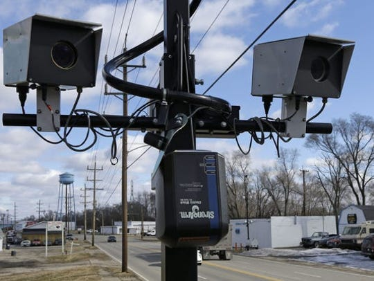 An example of a traffic enforcement camera is captured here. A lawsuit was filed against New Richmond over two cameras in the village.