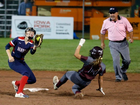 Shea Peterson of Alta-Aurelia tries to make the tag as Evalyn Robinson of North Linn slides into second during the 2A state championship softball game Thursday, July 25, 2019.