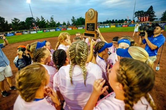 Collins-Maxwell players celebrate after beating Clarksville in the 1A state championship softball game Thursday, July 25, 2019.