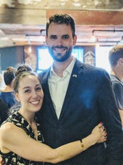 Zach Wahls and fiance Chloe Angyal at the watch party for the state senator primary race Wahls won in June, 2018.