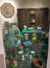 One section of the exhibit features 75 green objects from the Michigan History Museum's collections.