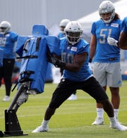 Lions linebacker Jarrad Davis goes through drills during practice during training camp on Friday, July 26, 2019, in Allen Park.
