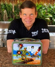 """""""America's Toy Scout"""" Joel Magee poses with the G.I. Joe lunchbox that started his collecting career."""