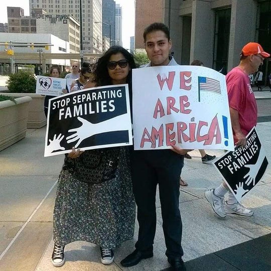 Adonis Flores, right, is a Detroit-based immigration activist.
