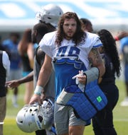 Lions fullback Nick Bawden walks off the field after practice during training camp on Friday, July 26, 2019, in Allen Park.