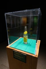 "The first artifact visitors encounter in ""Secret Lives of Michigan Objects,"" this Vernor's bottle is part of the exhibit's playful look at how and why museums collect and display objects."