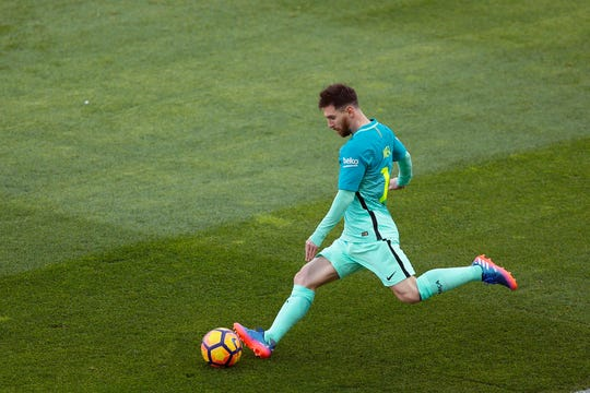 FC Barcelona's Lionel Messi kicks the ball during a match vs. Atletico de Madrid in Madrid, Spain, Feb. 26, 2017.