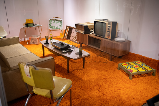 A central feature of the exhibit is a partially re-created 1970s basement, where visitors can suggest artifacts to complete the picture of Michigan life in the era.