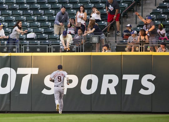 Tigers right fielder Nicholas Castellanos watches the ground rule double by Mariners catcher Omar Narvaez bounce into a fan's glove in the fourth inning of the Tigers' 10-2 loss on Thursday, July 25, 2019, in Seattle.