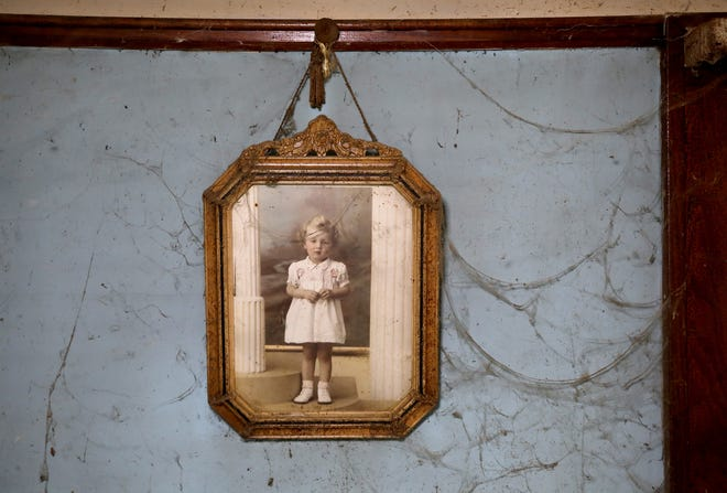 Surrounded by cobwebs from years of not being cleaned, a picture of Sally Honeycheck, taken back in the 1930's, has hung on the walls for decades in the house she shared with her sister Lorraine Honeycheck in Detroit, Michigan as seen on Sunday, June 23, 2019. The sisters lived in squalor for decades and Sally, alone in the house, died in mid to late November 2018.