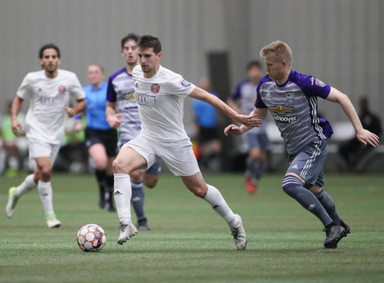 Midfielder Steven Juncaj of the Michigan Stars in action against the Kalamazoo FC this season.