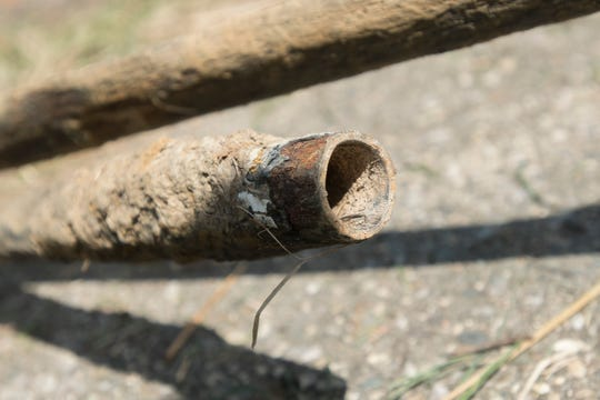 A section of lead pipe that was removed by crews replacing lead-tainted service lines at homes on the 1200 block of Durand in Flint, August 31, 2016.