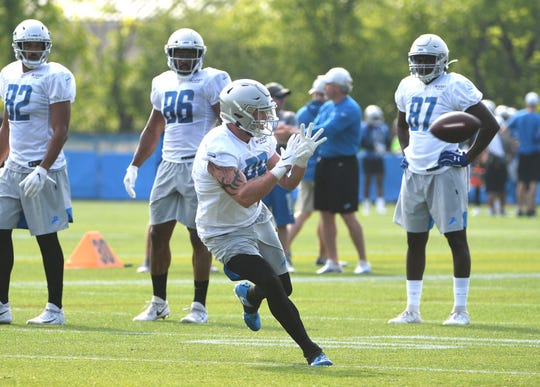 Lions tight end Isaac Nauta readies for a reception during drills.