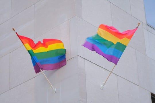 Gay pride flags on the Romney Building in Lansing in June.