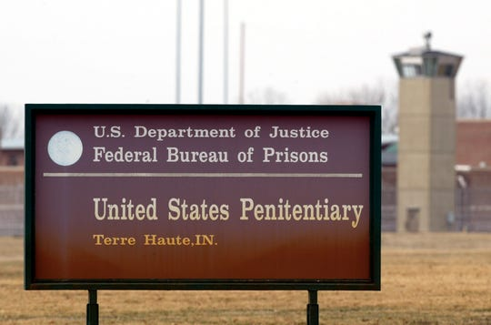 In this March 17, 2003 file photo, the guard tower flanks the sign at the entrance to the U.S. Penitentiary in Terre Haute, Ind., the site of the last federal execution.