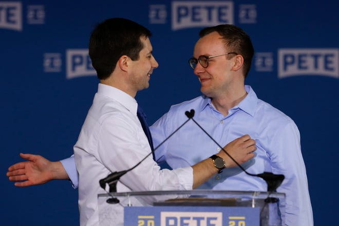 Pete Buttigieg is joined by his husband Chasten Buttigieg after he announced that he will seek the Democratic presidential nomination during a rally in South Bend, Ind. on April 14, 2019.