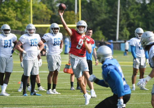 Lions quarterback Matthew Stafford throws to the end zone during practice.