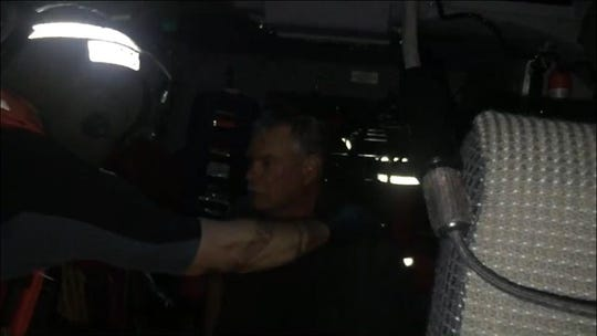 The two men were rescued after 14 hours in the water.