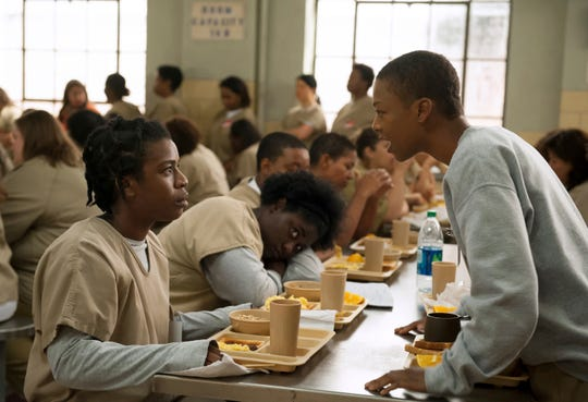"Uzo Aduba, left, and Samira Wiley appear in a scene from ""Orange is the New Black."""