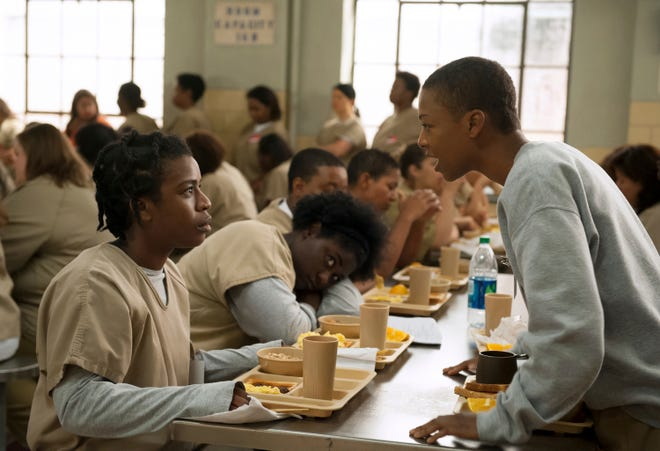 """Uzo Aduba, left, and Samira Wiley appear in a scene from """"Orange is the New Black."""""""