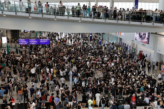 Demonstrators gather during a protest at Hong Kong International Airport, Friday, July 26, 2019.