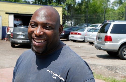 In this July 23, 2019, photo, auto repairman Terrance Holmes is interviewed in Detroit.