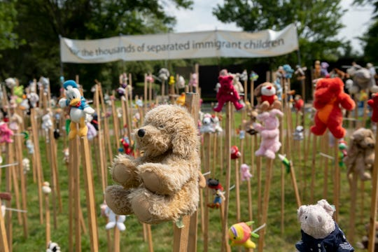 Dozens of stuffed toys on wooden stakes stand as part of an installation outside the Birmingham Temple Congregation for Humanistic Judaism, in Farmington Hills, in protest to the Trump administration's policy of separating migrant children from their families at the U.S. border with Mexico.