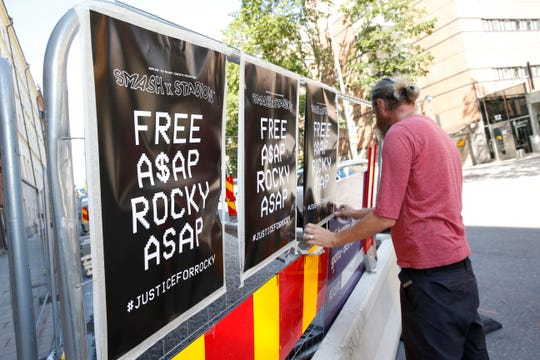 A man displays posters in support of US rapper A$AP Rocky, real name Rakim Mayers, outside the Kronoberg custody in Stockholm, Sweden, Thursday,  July 25, 2019.