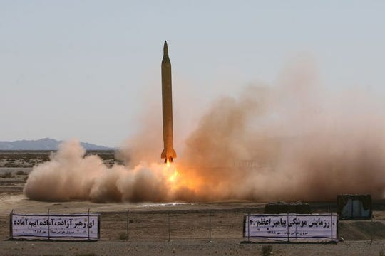 An Iranian long-range Shahab-3 missile is fired in desert terrain at an unspecified location in Iran on Sept. 28, 2009.