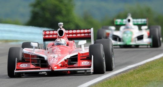 Scott Dixon of New Zealand drives through The Boot during practice for the IndyCar Series race at Watkins Glen in 2008. NASCAR does not use The Boot section of the track.