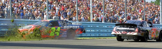 Jeff Gordon is slammed into the wall by Kevin Harvick after running out of gas on the last lap approaching the 2003 Cup Series race at Watkins Glen.